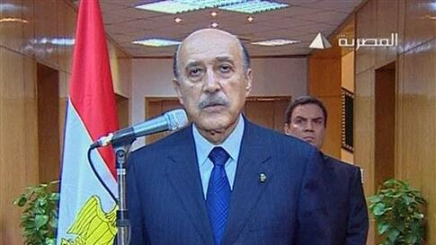 In this photo taken from Egyptian television, Egypt's vice president Omar Suleiman makes the announcement that Egyptian President Hosni Mubarak has stepped down from office, Friday, Feb. 11, 2011, in Cairo, Egypt. (AP Photo/Egypt TV) TV OUT - EGYPT OUT