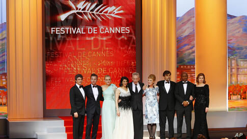 From left members of the jury Alexander Payne, Ewan McGregor, Diane Kruger, Hiam Abbass, Jean-Paul Gaultier, Andrea Arnold, Nanni Moretti, Raoul Peck, and Emmanuelle Devos at the opening ceremony at the 65th international film festival, in Cannes, France,