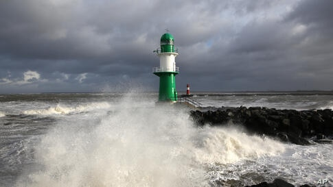 The lighthouse in the harbor of Rostock-Warnemuende. at the Baltic Srea, eastern Germany is flooded. A storm  with hurricane-force gusts hit Germany's costal areas as well as Britain, Belgium, The Netherlands, Scandinavia and Poland.