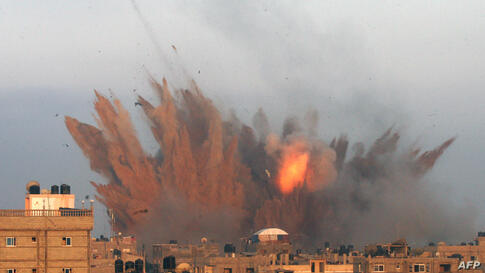 A ball of fire is seen following an Israeli air strike in Rafah, in the southern Gaza Strip. Israeli warplanes kept up deadly raids on Gaza but failed to stop Palestinian militants firing rockets across the border, as the U.S. offered to help negotiate...