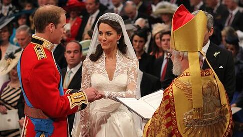 Britain's Prince William and Kate Middleton exchange rings in front of the Archbishop of Canterbury at Westminster Abbey, London, Friday April 29, 2011. (AP Photo/Dominic Lipinski, Pool)