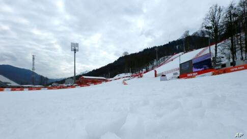 Soft tufts of snow protrude the surface in the finish area of the alpine ski course at the Sochi 2014 Winter Olympics. Warm temperatures in the mountains made the snow too soft and caused the cancellation of women's downhill training, Krasnaya Polyana,...