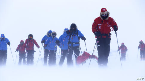 Photo issued by Walking with the Wounded (WWTW) shows Britain's Prince Harry (R), partron of Team UK in the South Pole Allied Challenge 2013 expedition, pulling the pulk which is guiding US team member Ivan Castro, who is blind, during ski training in ...
