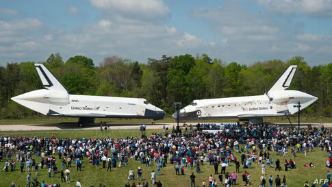 Space Shuttles Enterprise, left, and Discovery meet nose-to-nose at the beginning of a transfer ceremony at the Smithsonian's Steven F. Udvar-Hazy Center in Chantilly, Virginia, April 19, 2012. (NASA/Smithsonian Institution/Carolyn Russo)