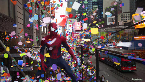 "A man dressed up as Spiderman poses for photos as he takes part in the annual ""air worthiness"" test of confetti in Times Square in New York, Dec. 29, 2013."