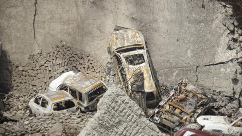 The collapsed upper car park of the Westgate Mall in Nairobi, Kenya. Working near bodies crushed by rubble in a bullet-scarred, scorched mall, FBI agents continued fingerprint, DNA and ballistic analysis to help determine the identities and nationaliti...