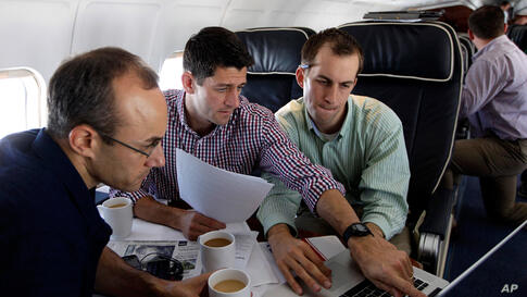 Vice presidential candidate Paul Ryan, center, works on the speech he will deliver at the Republican National Convention, with senior adviser Dan Senor, left, and senior aid Conor Sweeney.