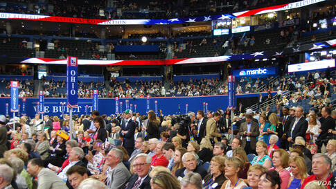 Delegates on the floor watch speakers during the second session. (J. Featherly/VOA)