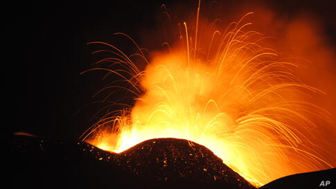 Lava spews from the South East Crater of Mt. Etna during an eruption, in Sicily, southern Italy.