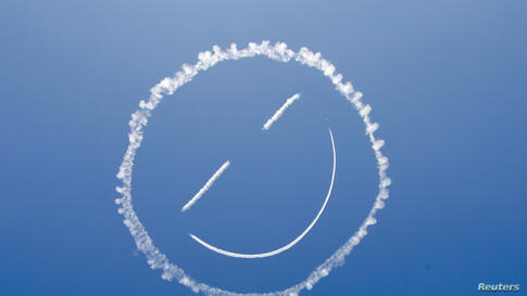 A sky writer draws a smiley face in the sky at the start of the Los Angeles County Air Show at General William J. Fox Airfield in Lancaster, California, Mar. 21, 2014.