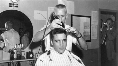 ** FILE ** In this March 1958 file photo, singer Elvis Presley gets his hair cut before entering the Army at Fort Chaffee in Barling, Ark. According the the U.S. Army, Presley entered the service March 24, 1958, at Fort Chaffee Reception Station. (AP Phot