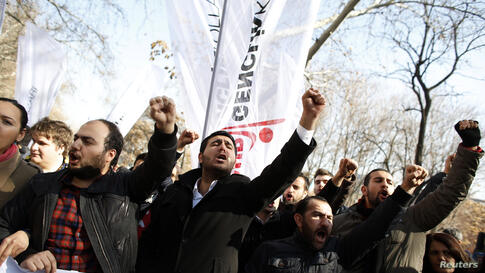 Protesters shout slogans against Turkey's Prime Minister Tayyip Erdogan during a demonstration in Ankara.