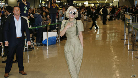 Lady Gaga poses for photographers upon her arrival at Narita International Airport in Narita, east of Tokyo. Gaga is in Japan to promote her new album ARTPOP.