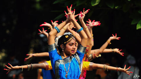 Indian schoolgirls participate in a traditional dance to commemorate 124th birth anniversary of India's late first Prime Minister Jawahar Lal Nehru at his ancestral home, Anand Bhawan, in Allahabad.