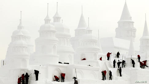 Craftsmen make a snow castle at a park in Changchun, Jilin province, China.