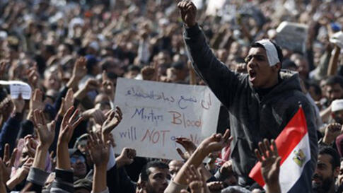 Anti-government protesters react in Tahrir Square, Cairo, Egypt, Friday, Feb. 4, 2011.