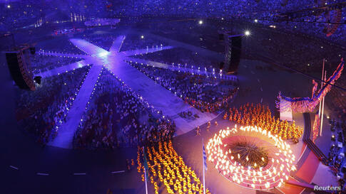 The Olympic Flame is being extinguished during the closing ceremony of the London 2012 Olympic Games at the Olympic Stadium August 12, 2012.