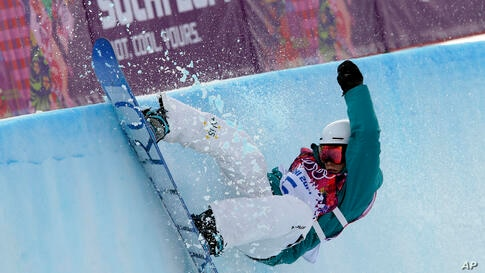 Australia's Holly Crawford competes in the women's snowboard half pipe at the Rosa Khutor Extreme Park, in Krasnaya Polyana, Feb. 12, 2014.