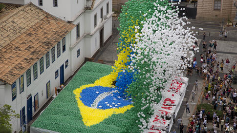 Members of Sao Paulo's Commerce Association release thousands of balloons with the color of the Brazilian flag to celebrate the end of the year in downtown Sao Paulo, Brazil.