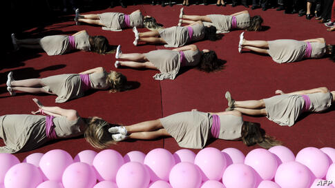 Members of Kosovo ballet perform during an event to raise awareness on breast cancer in Pristina.