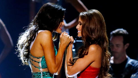 Miss North Dakota Audra Mari, left, and Miss Nevada Nia Sanchez await the final decision during the Miss USA pageant in Baton Rouge, Louisiana, June 8, 2014. Sanchez would go on to win the Miss USA title.