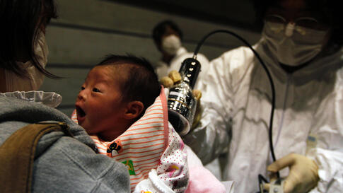 Nagashima Rio, who was born four days after the 2011 Fukushima earthquake and tsunami, is tested for possible nuclear radiation at a local evacuation center.  (REUTERS/Kim Kyung-Hoon)