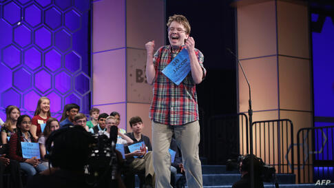 Speller Jacob Daniel Williamson of Cape Coral, Florida, reacts after he correctly spelled a word during round five of the 2014 Scripps National Spelling Bee competition in National Harbor, Maryland.