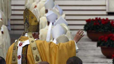 Pope Benedict XVI blesses faithful as he arrives in St. Peter's square at the Vatican to lead a Canonization Mass, Sunday, Oct. 17, 2010. Tens of thousands of people have packed St. Peter's Square for the canonization of Australia's first saint and  five