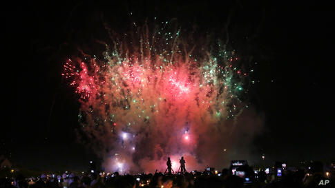 Fireworks lit the sky during King Bhumibol Adulyadej birthday celebrations, in Bangkok. Thailand's revered King Bhumibol Adulyadej marked his 86th birthday with a call for national unity, but failed to offer guidance on how his polarized nation might f...
