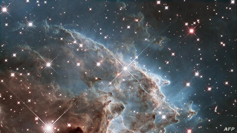 This handout image by the ESA and taken by the NASA/ESA Hubble Space Telescope shows the Monkey Head Nebula or NGC2174, to celebrates its 24th year in orbit. NGC 2174 lies about 6400 light-years away in the constellation of Orion (The Hunter). Hubble p...