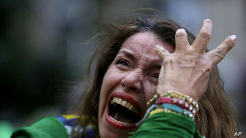 A Brazil soccer fan cries as Germany scores against her team at a World Cup semifinal match as she watches the game on a live telecast in Belo Horizonte, Brazil, July 8, 2014.