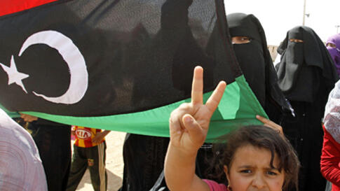 Libyan refugees who fled the unrest in Libya hold a protest against Libyan leader Muammar Gaddafi at a refugee camp near the southern Libyan and Tunisian border crossing of Dehiba, April 28, 2011