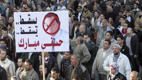 Egyptian anti-Mubarak protesters shout out during a protest in al Manoura,  Egypt, Feb 8, 2011