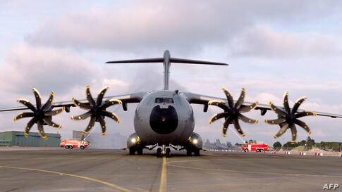 The new French air force military transport Airbus A 400M is welcomed by fire engines at the military airbase BA 123 in Saint-Jean-de-la-Ruelle near Orleans (central France) as part of an official presentation.