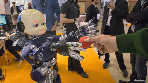 A humanoid robot from IIT is displayed during the Innorobo 2014 fair (Innovation Robotics Summit) in Lyon, France, Mar. 18, 2014. Innorobo is an annual venue for companies and research centers to present their latest technologies in robotics.