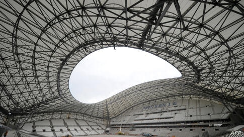 Technicians work on the renovation of the Stade Vélodrome in Marseille, France.
