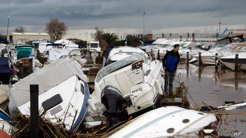 Motor boats sunk in the port of La Londe Les Maures, near Toulon, southern France after unusually heavy rains flooded the French Riviera, leaving two people dead and some thousands without electricity or access to roads.
