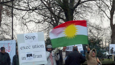 Kurds demonstrating in London to protest the death sentence ordered by an Iranian court against Habibulla Latifi, Tuesday December 28 2010
