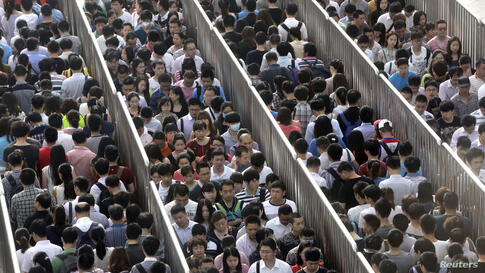 Passengers line up and wait for a security check during morning rush hour at Tiantongyuan North Station in Beijing. China tightened security checks at subway stations following an attack in country's troubled Xinjiang region which killed 31 people on M...