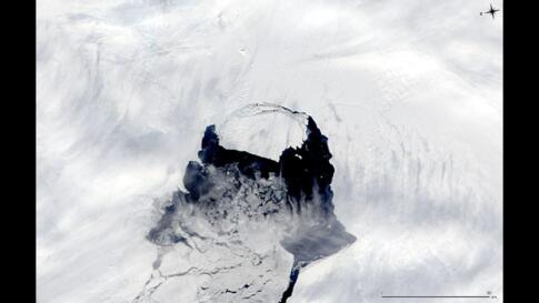 This MODIS image taken by NASA's Aqua satellite shows an iceberg that was part of the Pine Island Glacier and is now separating from the Antarctica continent. What appears to be a connection point on the top left portion of the iceberg is actually ice ...