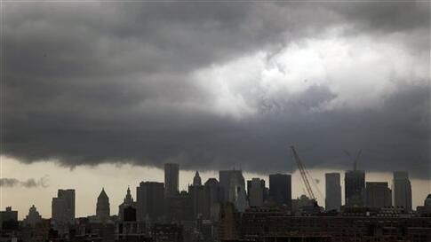 Dark clouds form over New York's downtown skyline on Thursday April 28, 2011.  The National Weather Service says a line of severe thunderstorms capable of producing a tornado is moving into the area and has issued a tornado warning for Rockland County and