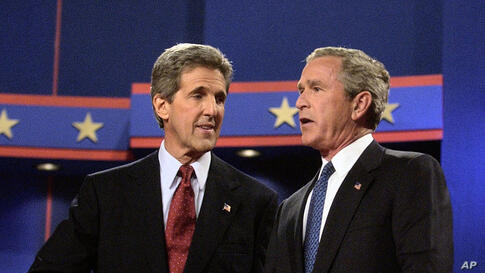 Then President George W. Bush and John Kerry greet each other at the end of their first presidential debate at the University of Miami in Coral Gables, Florida, September 30, 2004.