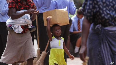 A young girl walks on the streets of Harare, Zimbabwe.