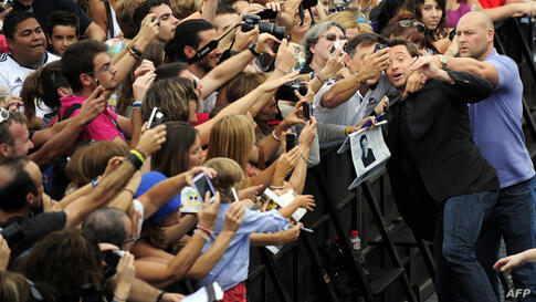 """Australian actor Hugh Jackman poses with fans after the screening of his film """"Prisoners"""" during the 61st San Sebastian Film Festival in the northern Spanish Basque city of San Sebastian."""