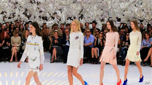 Models wear creations by Belgian fashion designer Raf Simons for Dior's Fall-Winter 2014-2015 Haute Couture fashion collection, in Paris, France.
