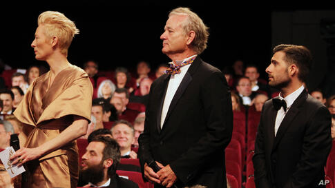 From left, actors Tilda Swinton, Bill Murray and Jason Schwartzman attend the opening ceremony at the 65th international film festival, in Cannes, France, May 16, 2012.
