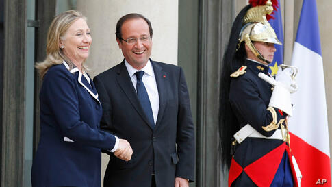 French President Francois Hollande and Secretary Clinton following their meeting at the Elysee Palace in Paris, July 6.