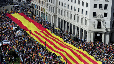 Anti-independentist Catalans hold a giant banner with a Catalan flag and a Spanish flag during a demonstration at Catalunya square in Barcelona, Spain.Tens of thousands of people demonstrated in Barcelona for the unity of Spain and against the indepen...