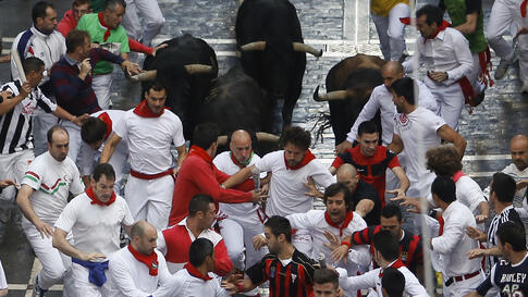 Jandilla fighting bulls run after revelers during the Running of the Bulls at the San Fermin festival in Pamplona, Spain. Revelers from around the world arrive in Pamplona every year to take part in eight days of festivities.
