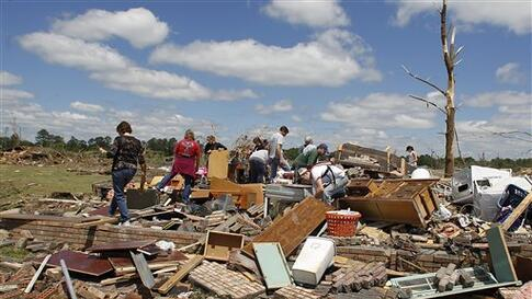 Residents search through what is left of their homes after a tornado hit Pleasant Grove just west of downtown Birmingham yesterday afternoon on Thursday, April 28, 2011, in Birmingham, Ala.  President Barack Obama said he would visit Alabama Friday to vie